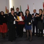 Commissioner Georgieva receiving P.A.V.E. from the EYV 2011 Alliance Working Groups co-chairs