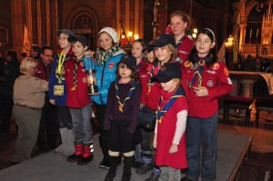 Christina carrying the Light of Peace from Bethlehem accompanied with young Austrian Scouts and Guides