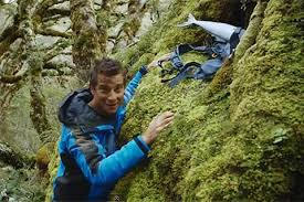 On the set: UK Chief Scout Bear Grylls storing his bag in the overhead compartment
