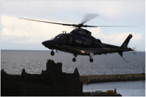 Bear's helicopter approaching Peel Hill on Ellan Vannin (Isle of Man)
