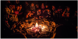 Enjoying a campfire with new friends while volunteering in Scouting abroad