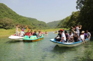 Rowing down one of the Omani rivers