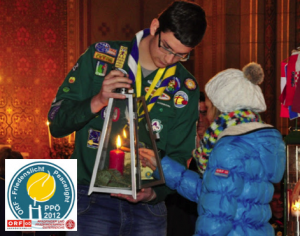 A Scout from Luxembourg has his Peace Light lantern lit (December 2012)