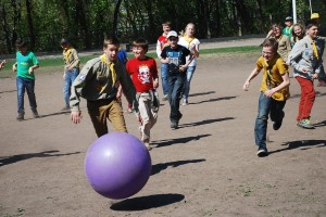 Scouts mixing with other young people just met in the park for fun games
