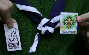 Emblem and national scarf of Cercetasii României and the Nocrich Scout Centre logo