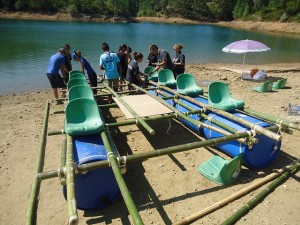One of last year's crews constructing their raft, including chairs for the rowers!