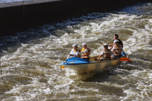 A Cub Scout crew mastering Helmovský weir in the 2014 regatta – the photographer stood at the same spot as his colleague in 1948!