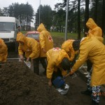 Scouts join other rescue teams in Sabac filling sand sacks to reinforce protective walls of that city